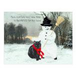 Gato negro y muñeco de nieve tarjetas postales