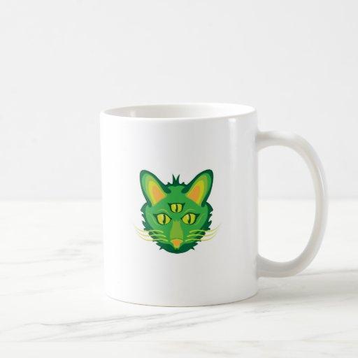 gato observado 3 tazas de café