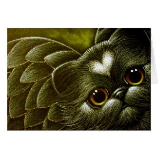 Gato persa negro del ángel con la tarjeta del