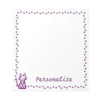 Gato púrpura con la frontera de la pata bloc de notas