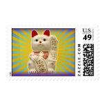 Gato que agita japonés de la buena suerte del gato sello