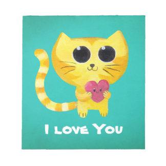 Gato romántico lindo con el corazón blocs