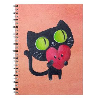 Gato romántico que abraza el corazón lindo rojo libros de apuntes con espiral