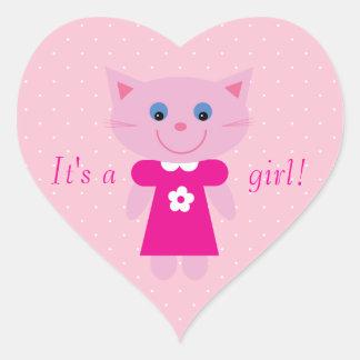 Gato rosado lindo del dibujo animado su un nuevo calcomanía corazón