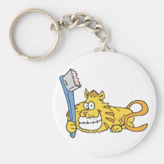 Gato sonriente con el cepillo de dientes llavero redondo tipo pin
