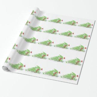 Gato travieso golpeado sobre el árbol de navidad papel de regalo