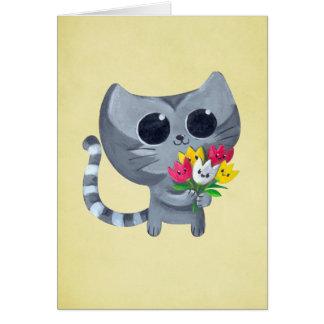 Gato y flores lindos del gatito