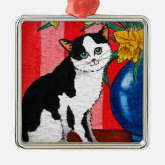 Gato y narcisos en un florero azul adorno navideño cuadrado de metal