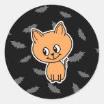 Gato y palos anaranjados pegatina