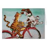 Gato y perro en la bici tarjeta