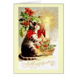 Gato y vela del vintage de la tarjeta de Navidad