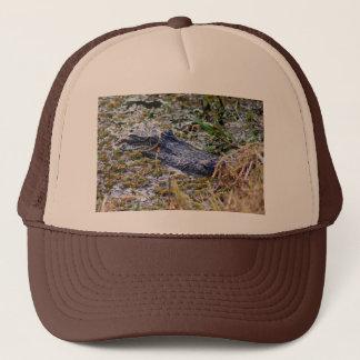 Gator hiding trucker hat