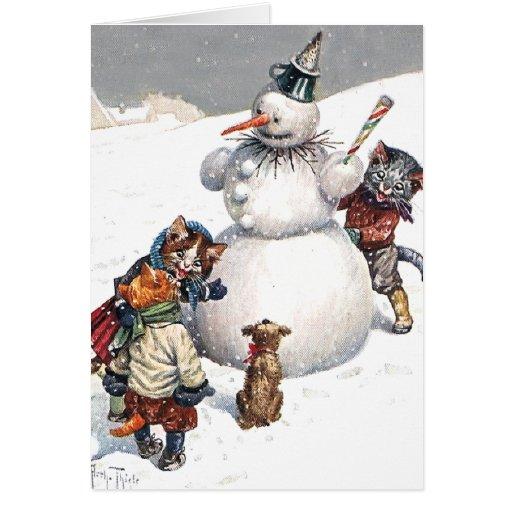 Gatos adorables que construyen un muñeco de nieve tarjetas