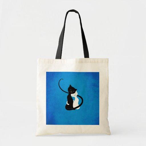 Gatos blancos y negros lindos azules en amor bolsas