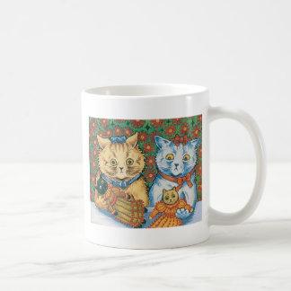 Gatos con las ilustraciones de las muñecas de taza