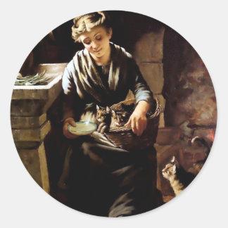 Gatos de alimentación de la mujer pintura antigua etiqueta redonda