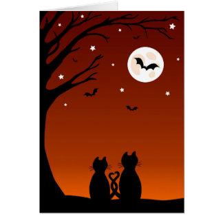 Gatos de Halloween que miran la luna Tarjetas