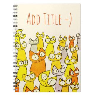 Gatos de la porción el mirar fijamente del naranja spiral notebooks
