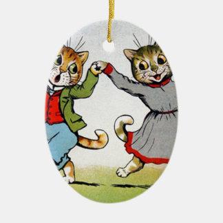 Gatos del baile adorno navideño ovalado de cerámica