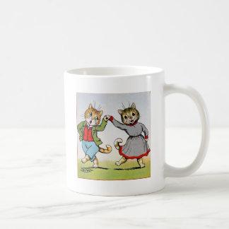 Gatos del baile taza de café