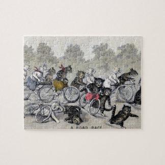 Gatos del montar a caballo de la bicicleta puzzle