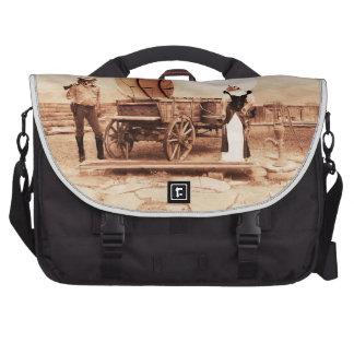 Gatos del oeste viejos con el carro cubierto bolsas para portátil