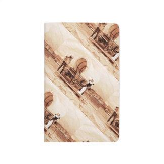 Gatos del oeste viejos con el carro cubierto cuaderno grapado
