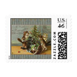 Gatos del sello de la postal que adornan el árbol