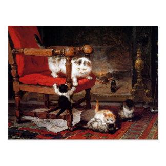 Gatos del vintage por la chimenea tarjeta postal