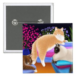 Gatos en el Pin recientemente doblado del lavadero