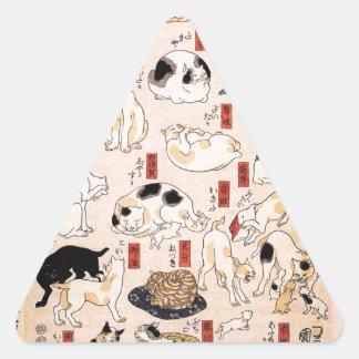 Gatos en las cincuenta y tres estaciones del pegatina triangular