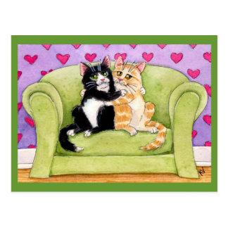 Gatos en postal del amor