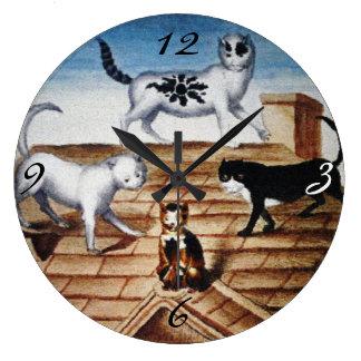 Gatos franceses del vintage en un tejado reloj de pared