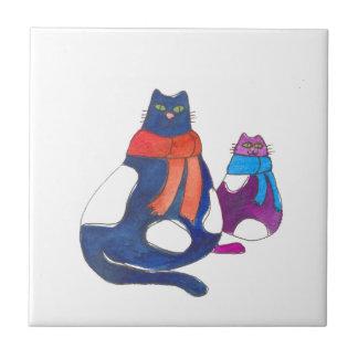 Gatos gordos en bufandas teja