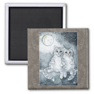 Gatos lindos en imán del claro de luna