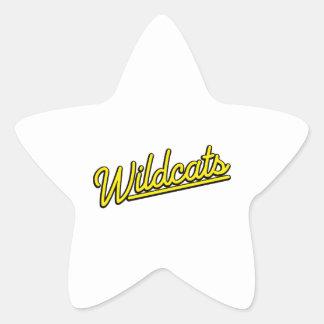 Gatos monteses en amarillo pegatina en forma de estrella