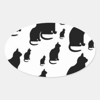 Gatos negros afortunados de la silueta del © P Pegatina Ovalada
