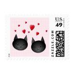 Gatos negros lindos con los corazones, en pálido - envio