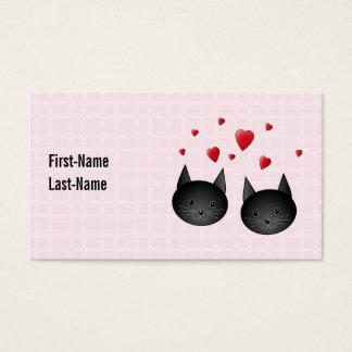 Gatos negros lindos con los corazones, en pálido - tarjetas de visita