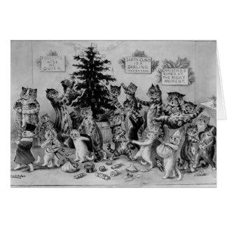 Gatos que adornan la tarjeta del árbol de navidad