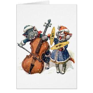 Gatos que juegan música del navidad en la nieve tarjeta de felicitación
