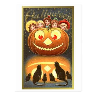 Gatos que miran niños y el vintage Halloween de la Postal