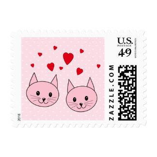 Gatos rosados con los corazones del amor timbre postal