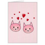 Gatos rosados lindos, con los corazones rojos del  tarjeton