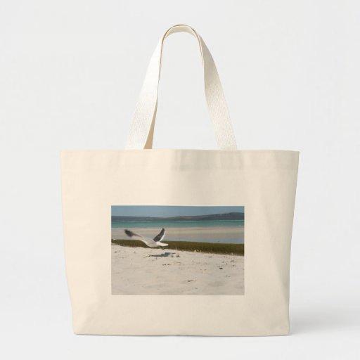Gaviota en vuelo bolsas de mano