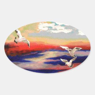Gaviotas coloridas del vuelo colcomanias oval personalizadas
