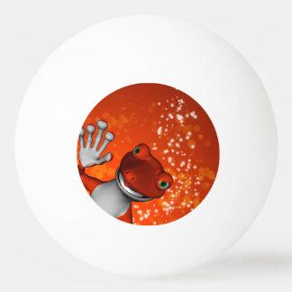 Gecko lindo en rojo pelota de tenis de mesa