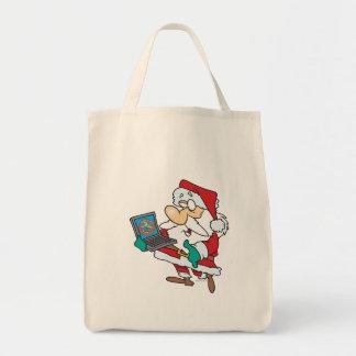 geeky technology savvy santa with a laptop cartoon bags