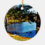 Geese swimming in half frozen lake - trees christmas tree ornaments