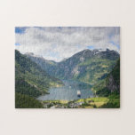 """Geirangerfjord view in Norway jigsaw puzzle<br><div class=""""desc"""">Jigsaw puzzle with the famous fjord Geirangerfjord,  a cruise ship and the village of Geiranger between the mountains in Norway.</div>"""
